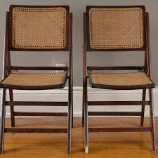 two vintage cherry and rattan folding chairs ebth