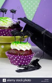 graduation cap toppers graduation day green and purple theme party with cupcakes and