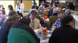 hundreds gather at massachusetts high school cafeteria to eat on