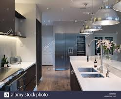 Lighting Above Kitchen Cabinets Modern Kitchen With Pendant Lights Above Island Unit Residential