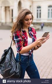 hipster girl young woman travel using smartphone happy face hipster girl sunset