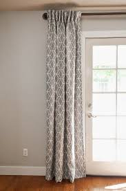 hang rod close to the ceiling even on french doors gray curtains over french doors but possibly with a navy wall beige wall would also work