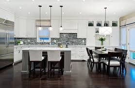 pendant lights over dining table kitchen transitional with island