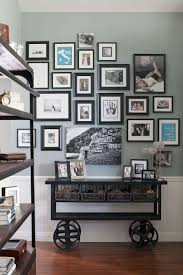 domestic bliss beverley mitchell s southern california home a gallery wall of family photos and meaningful prints takes pride of place above an antique