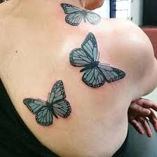 three butterfly tattoos on right back shoulder for
