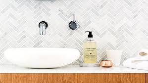 tile inspiration for a striking bathroom bathroom sink marble chevron tiles may15