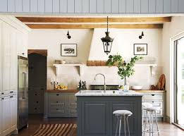 shabby chic kitchen ideas with sleek bar stools and black iron