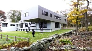 exterior unique white container houses with dark metal column and