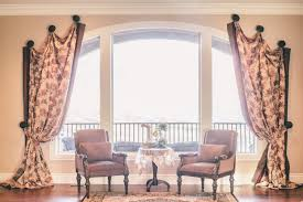 large arched window treatment idea with floral curtain with topper
