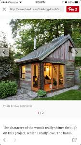 the backyard house built from recycled barnboards backyard