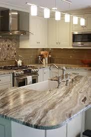 white kitchen cabinets with taupe backsplash 50 popular brown granite kitchen countertops design ideas