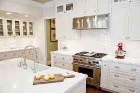 white shaker kitchen cabinets backsplash white shaker kitchen cabinets with mini subway tile
