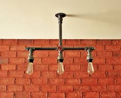 bathroom brick accent walls and light bulb with steampunk