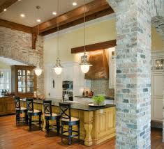 divine industrial brick kitchen featuring red bricks wall and