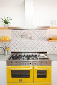 backsplash for yellow kitchen white and yellow kitchen with yellow stove contemporary kitchen