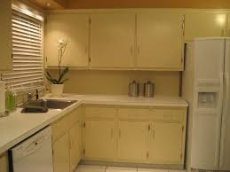 Yellow And Brown Kitchen Ideas by Yellow And White Painted Kitchen Cabinets With Brown Countertops T