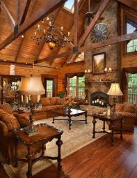 the home interiors a fireplace anchors this custom log home the timber