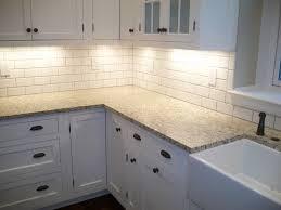 concrete backsplash white kitchen with subway tile backsplash