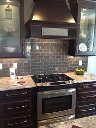 Subway Tile Backsplash In Kitchen Ice Gray Glass Subway Tile Dark Brown Cabinets Subway Tile
