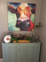 cow picture with farmhouse decor decorate like this