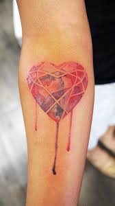 forearm watercolour heart gem tattoo chronic ink
