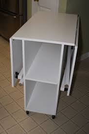 craft cabinet with fold out table great folding craft table with storage with best 10 folding sewing
