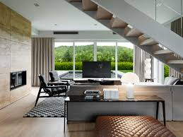 living room how to use space under stairs mondeas