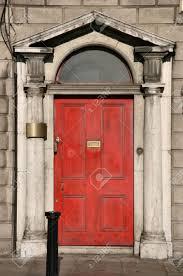 georgian architecture of dublin red door in old building stock