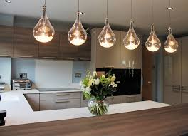handled german kitchen with statement lighting and gaggenau