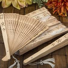 fan favors intricately carved sandalwood fan favors fashioncraft