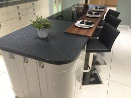 gloss stone shaker island unit with curved units induction hob
