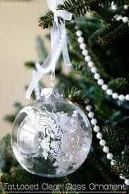 large clear ornament the hat from the hospital id bracelets