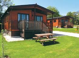 captivating log cabin christmas holidays uk using wooden exterior