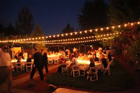 backyard wedding with italian string lights hung overhead and