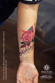 watercolour rose tattoo with name by sunny bhanushali aliens tattoo