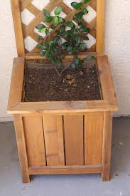 brown wooden raised planter box plans in a simple design living