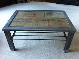 steel frame coffee table with antique explosives box and glass