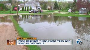 poor drainage turns front yard into pond in ortonville youtube