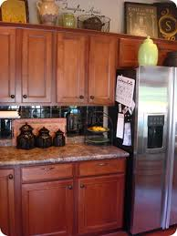 above kitchen cabinet decorating ideas how to decorate above kitchen cabinets from thrifty decor