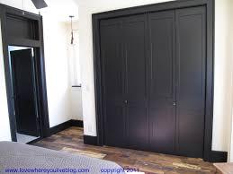 dark trim and interior doors an ordinary bi fold door closet