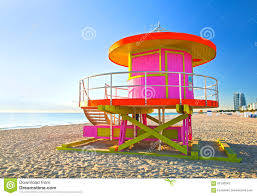 sunrise in miami beach florida with a colorful pink lifeguard