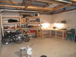 Woodworking Plans Garage Shelves by Industrial Style Garage With Corner Workbench In L Shape Made Of