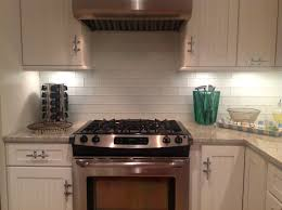 kitchen hanging track lamps large stone backsplash kitchen