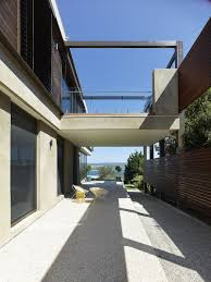 exterior design waterfront hill house architecture with lake view hard floor veranda contemporary house design