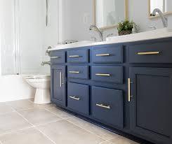 navy vanity modern classic guest bathroom makeover reveal