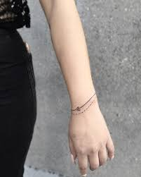 single line dotted line bracelets tattoos