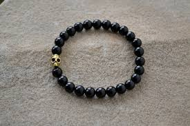 black onyx beads bracelet images Black onyx beads with a gold day of the dead skull jpg