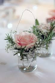 wedding flowers east sussex table decor jam jar flowers pink roses gypsophila rosemary