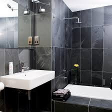 black tile bathroom ideas small black bathroom understated white sanitaryware provides a