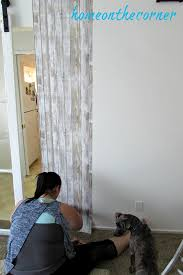 papering the wall with barnwood wallpaper u2013 home on the corner